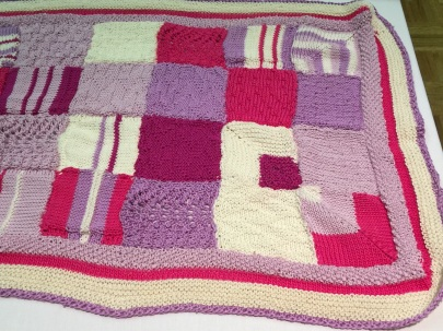 Honey Mitchell - knitted blanket with mitred corners